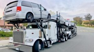 car-carrier-auto-transport-truck-filled-with-cars-ready-for-a-cross-country-road-trip-delivery