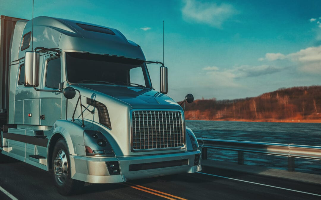 Blue truck running on the road scaled
