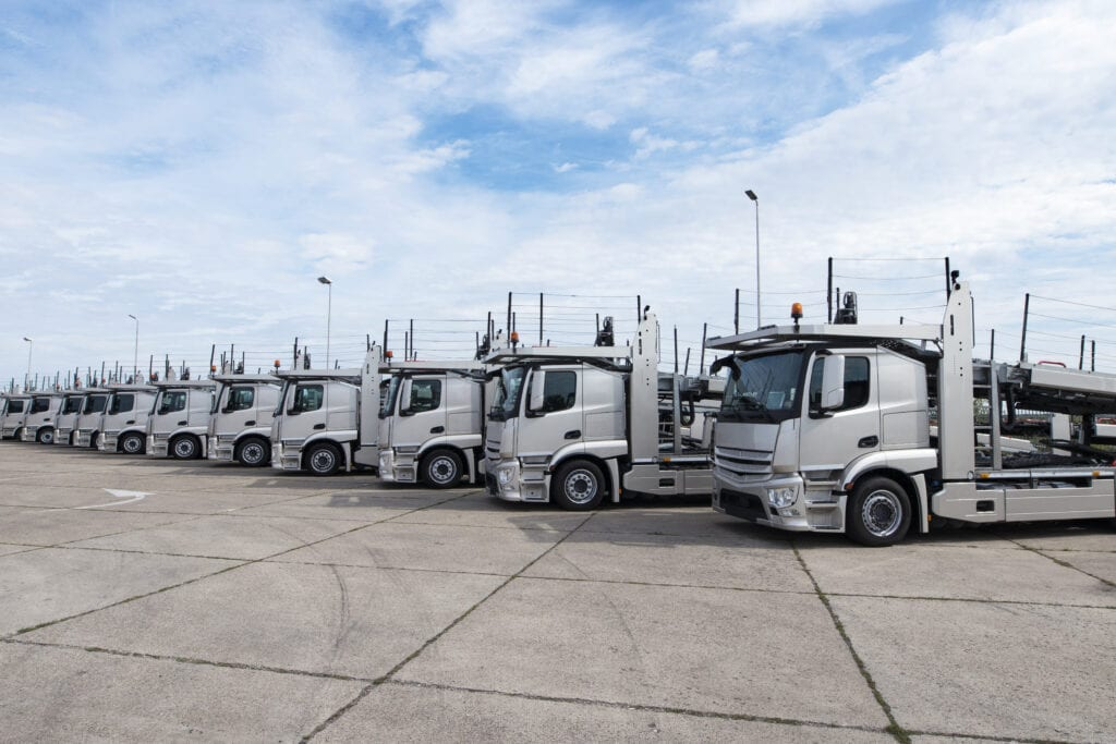 group-of-trucks-parked-in-line-at-truck-stop