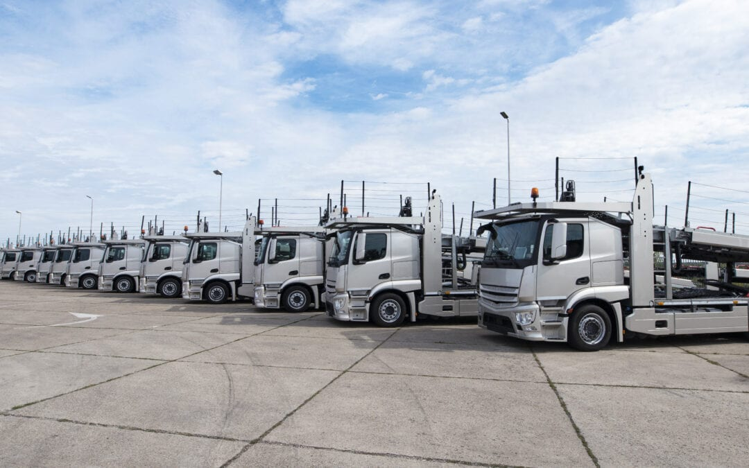 Group of trucks parked in line at trick stop scaled
