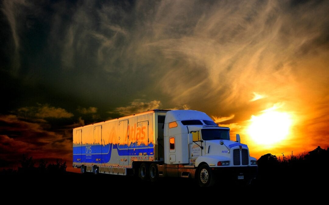 Truck transport under the sunset